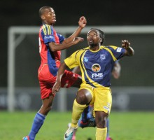 Cape Town, South Africa - JULY 29: elby Mohlaki of TUT and Xolisa Sigenu of UWC during the Varsity Football match between University of Western Cape and the Tshwane University of Technology at the UWC Stadium