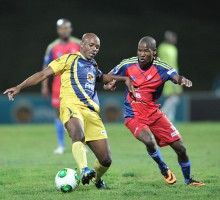 Cape Town, South Africa - JULY 29: Oupa Sawukazi of UWC and Selby Mohlaki of TUT during the Varsity Football match between University of Western Cape and the Tshwane University of Technology at the UWC Stadium