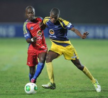 Cape Town, South Africa - JULY 29: Andrew  Mashigo of TUT and Thando Ziwele of UWC during the Varsity Football match between University of Western Cape and the Tshwane University of Technology at the UWC Stadium