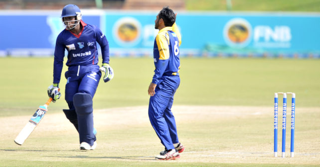 VARSITY CRICKET in Potchefstroom where Kovsies plays UWC.Sipo Mavanda fromKovsies comes in from a run,while Dawood Christians,awaits the ball.photo matio van de Wall/SASPA