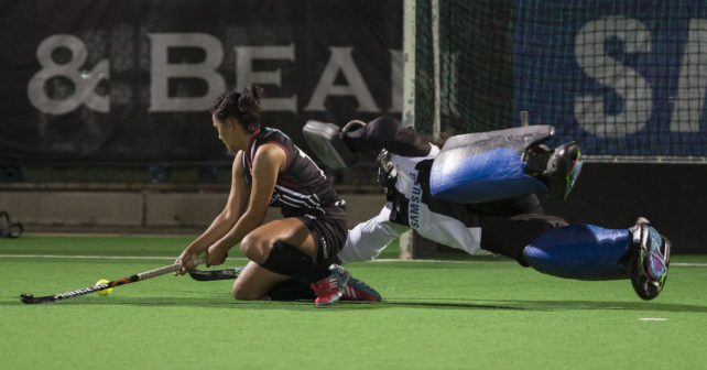 Charne Maddocks of PUKKE slide a backhand shot while Nicole LE Fleur of Maties attempts to save it during a penalty shoot out after both teas failed to score during the match in the 2017 VARSITY HOCKEY,  Monday 8  May 2017 Danie Craven Stadium, Stellenbosch, Western Cape.  Photo by: HALDEN KROG/SASPA