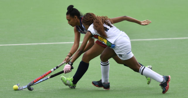20170517 Varsity Hockey in Potchefstroom where Kovsies plays Kwazulu Natal.Nqobile Shange from KZN,plays a ball and try to shield it away fromHeraldine Olin,from Kovsies.photo Mario van de Wall/SASPA--h2