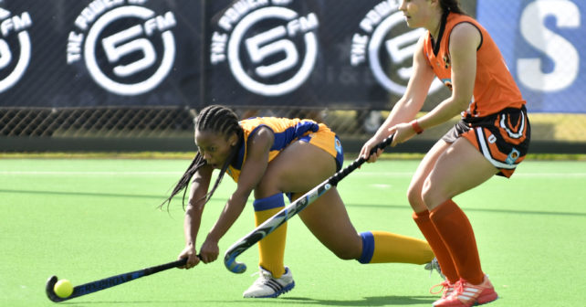 20170517 Varsity Hockey for Woman, in Potchefstroom,where the teams of UJ plays against Wits.Nicky Veto from Wits hits a ball away from Ashley Datnow from UJ.photo Mario van de Wall/SASPA