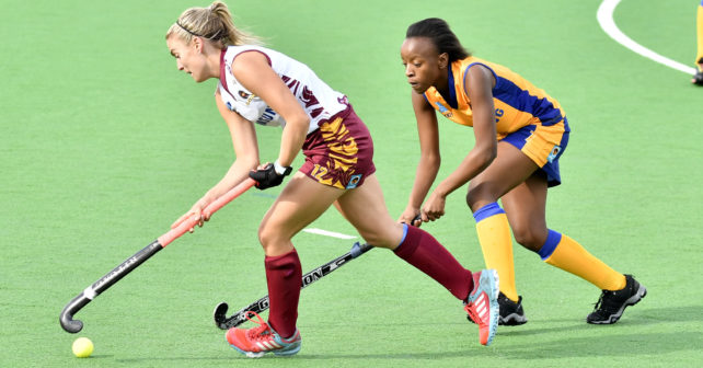 20170513 Varsity Hockey in Potchefstroom on the Astro,where Wits is playing Maties.Natasha Rootenberg runs with the ball and Nicky Veto from Wits is trying to stop her.photo Martio van de Wall/SASPA