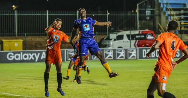 Dane Fortuin of UJ and Thabiso Rafanyane of Wits go for the header during the Varsity Football match between UJ and Wits at Wits Stadium in Johannesburg on 17 August, 2017. Photo by Dominic Barnardt/Varsity Sports