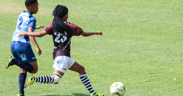 Kgosietsile Nthabiseng and Refilwe Leeuw in a rrace with the  ball during the Varsity Football match between NWU and CUT at Fanie du Toit Sports Grounds in Potchefstroom on 23 September 2017