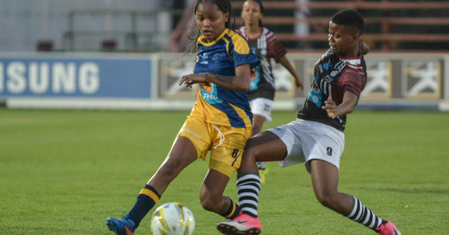 MOREMI PULENG from UWC running with the ball and  Amanda Citywayo Trying to get it during the Varsity Football match between NWU and Tuks at Fanie du Toit Sports Grounds in Potchefstroom on August 10, 2017.