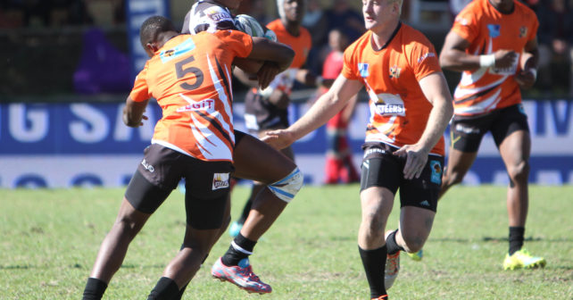 Varsity 7's, Villagers RFC, Cape Town.  30 April 2016.  Photo:  Thys Lombard    Luyolo Fata (WSU 4) with ball is stopped by two players from UJ