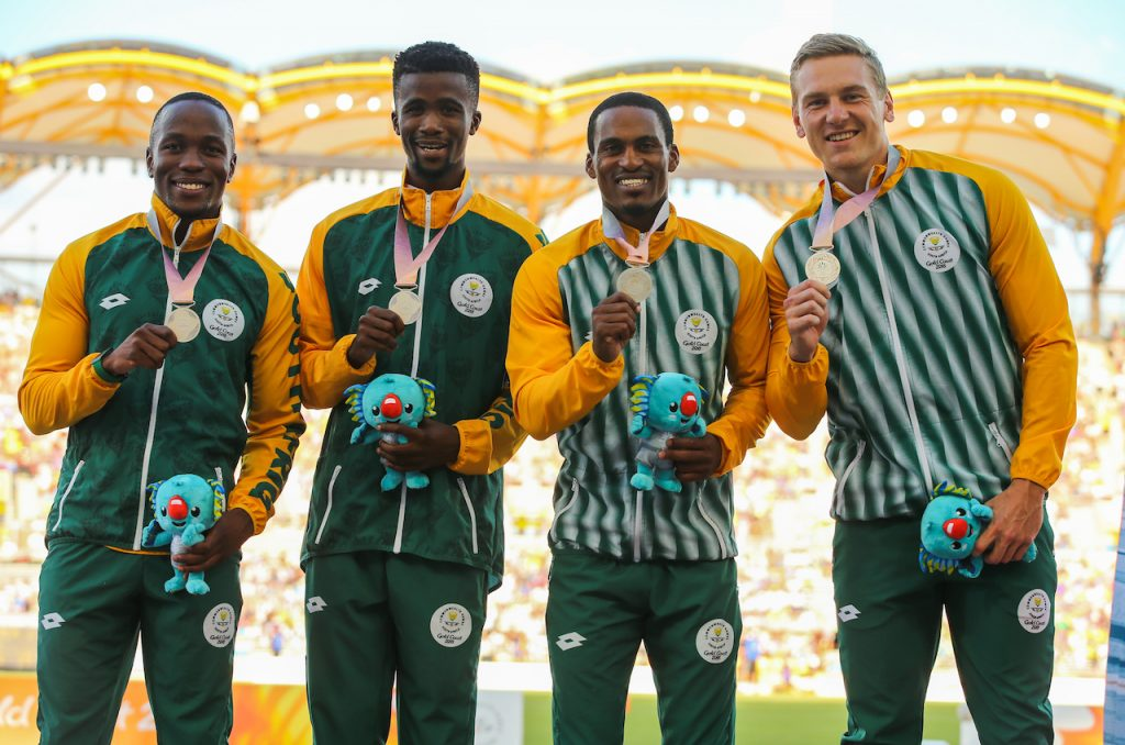 GOLD COAST, AUSTRALIA - APRIL 14: Akani Simbine, Anaso Jobodwana, Henricho Bruintjies and Emile Erasmus of South Africa with their silver medal in the mens 4x100m relay final during the athletics on day 10 of the Gold Coast 2018 Commonwealth Games at the Carrara Stadium on April 14, 2018 in Gold Coast, Australia.  (Photo by Roger Sedres/Gallo Images)