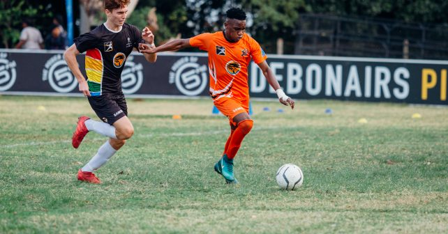UJ handles the ball upfield during Varsity Football match between UKZN and UJ at Howard College Stadium in Durban on August 16, 2018