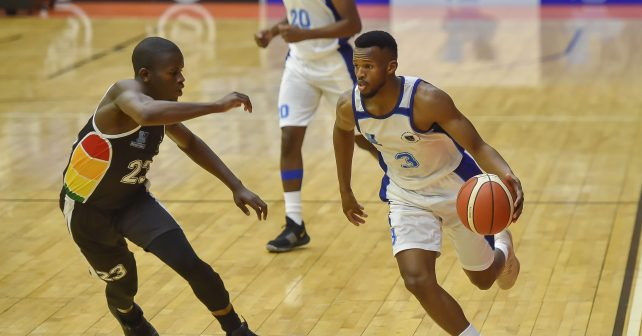 Bubele Monakali (23) from University of KZN and Siphumle Qanya (C) (3) from University of Cape Town during the Varsity Sports Basketball Match 21 UCT vs UKZN on October 13, 2018 at Wits Multi-Purpose Hall in Johannesburg, South Africa. #Varsitybasketball  (Photo by Christiaan Kotze/SASPA)