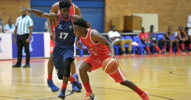 Manelisi Mthiyane (9) from Tukkies is defended by Junior Bekale (17) from TUT  during the Varsity Sports Basketball match 06 between TUT vs UP TUKS on October 06, 2018 at Wits Multi-Purpose Hall in Johannesburg, South Africa. #Varsitybasketball  (Photo by Craig Nieuwenhuizen/SASPA)