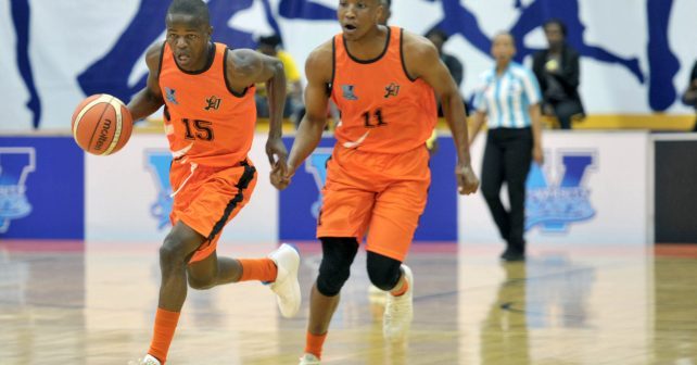 Lance Chikore (15) from University of JHB with ball in hand and Nqosa Lehloenya (11) from University of JHB during the Varsity Sports Basketball match 08 between UJ vs UCT on October 06, 2018 at Wits Multi-Purpose Hall in Johannesburg, South Africa. #Varsitybasketball  (Photo by Craig Nieuwenhuizen/SASPA)