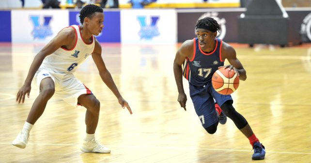 Junior Bekale (17) from TUT with ball in hand and Thabiso Magakabe (6) from Vaal University of Technology during the Varsity Sports Basketball match 09 between TUT vs VUT on October 06, 2018 at Wits Multi-Purpose Hall in Johannesburg, South Africa. #Varsitybasketball  (Photo by Craig Nieuwenhuizen/SASPA)