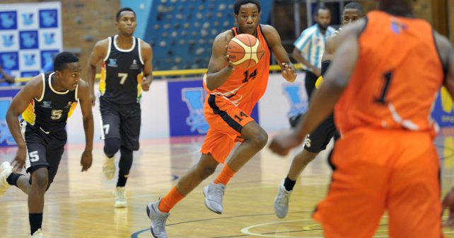 Nathan Baruti (14) from University of JHB with ball and Zolani Khuzwayo (5) from University of KZN andhabo Sithole (7) from University of KZN during the Varsity Sports Basketball match 12 between UJ vs UKZN on October 06, 2018 at Wits Multi-Purpose Hall in Johannesburg, South Africa. #Varsitybasketball  (Photo by Craig Nieuwenhuizen/SASPA)